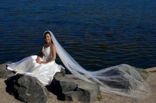 Beautiful bride on the waters edge