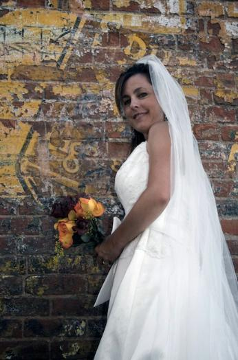 Smiling bride in the back-alleys of Ft. Collins